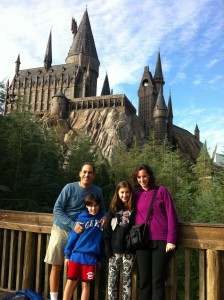 Our family poses in front of Hogwarts